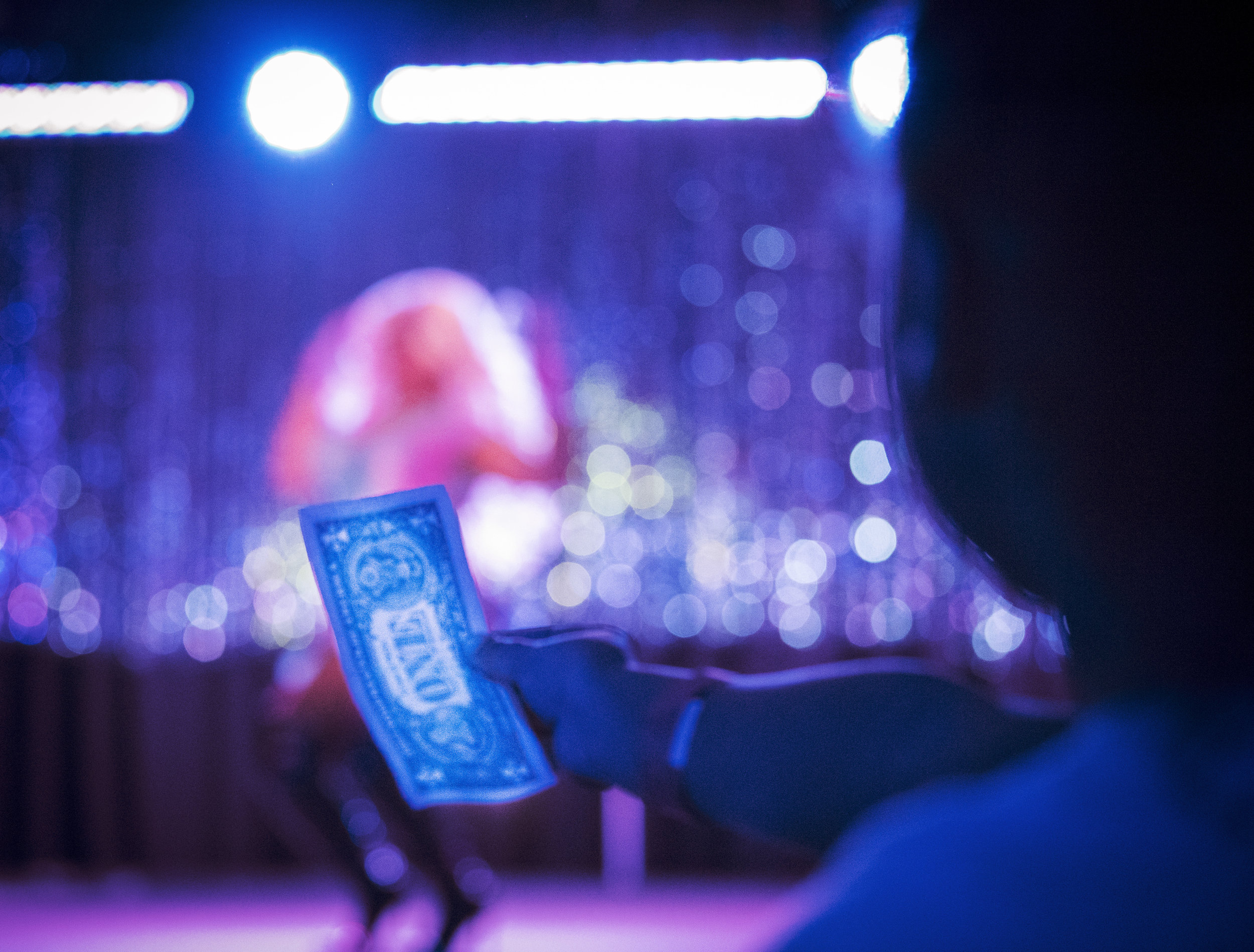 Audience members stood by the stage with arms outstretched and dollar bills in hand as the performers paraded their effervescent costumes to some of their favorite songs at the WKU Drag Show.
