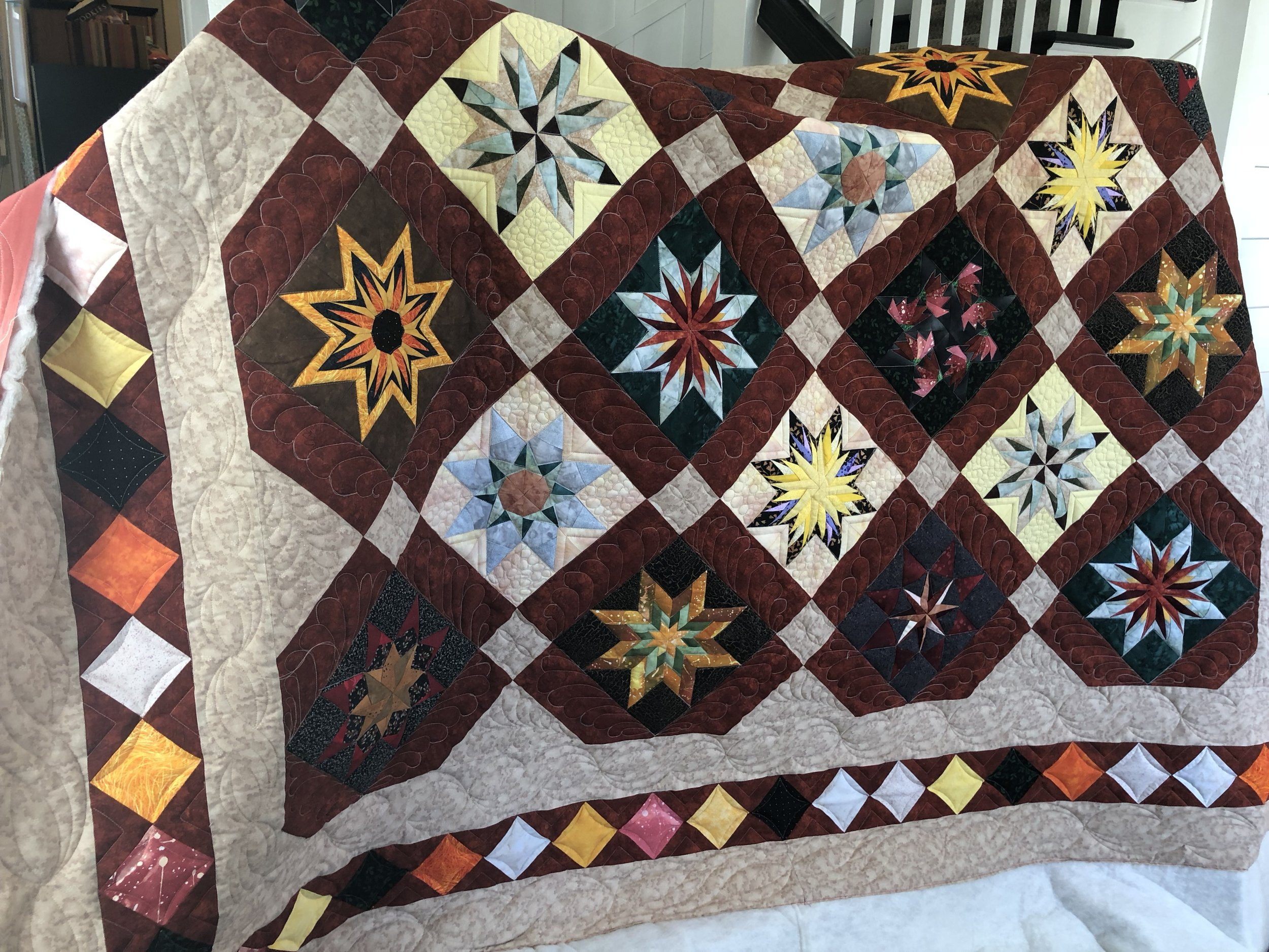Theora's Quilt: Ruler, FMQ, and Digitized Designs
