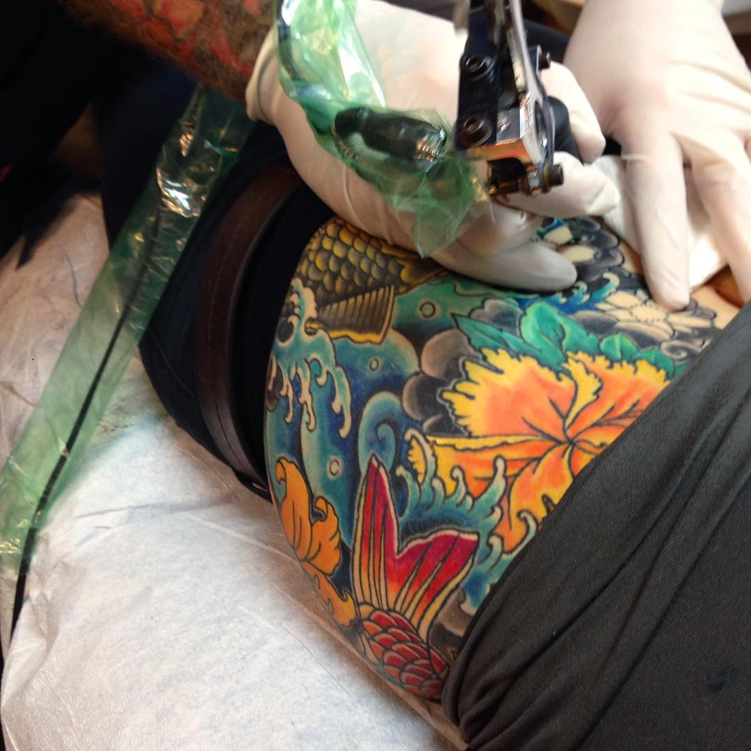 floral and koi bodysuit tattoo