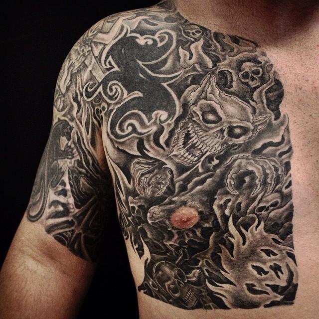 black and gray skulls tattoo