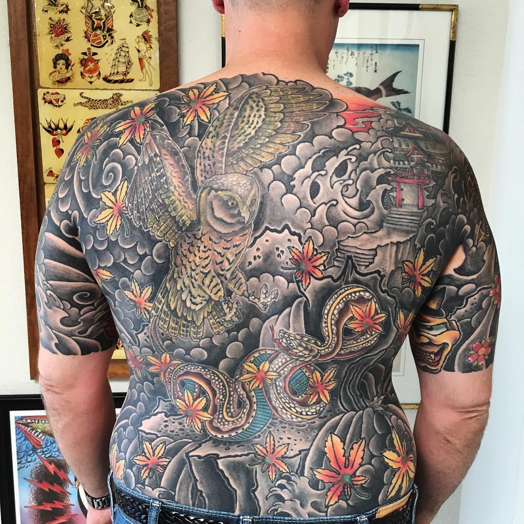 japanese owl and maple leaves backpiece tattoo