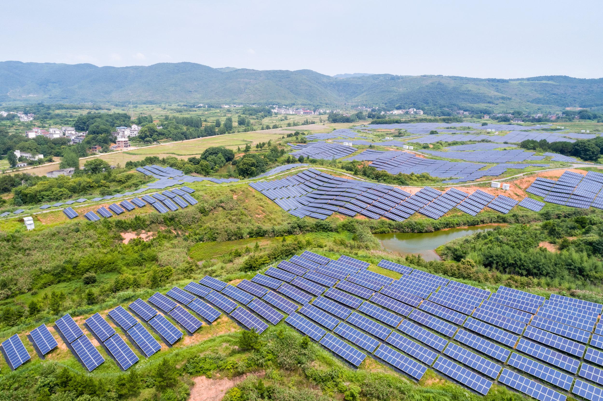 aerial-view-of-hillside-solar-energy-C7DR8PA.jpg