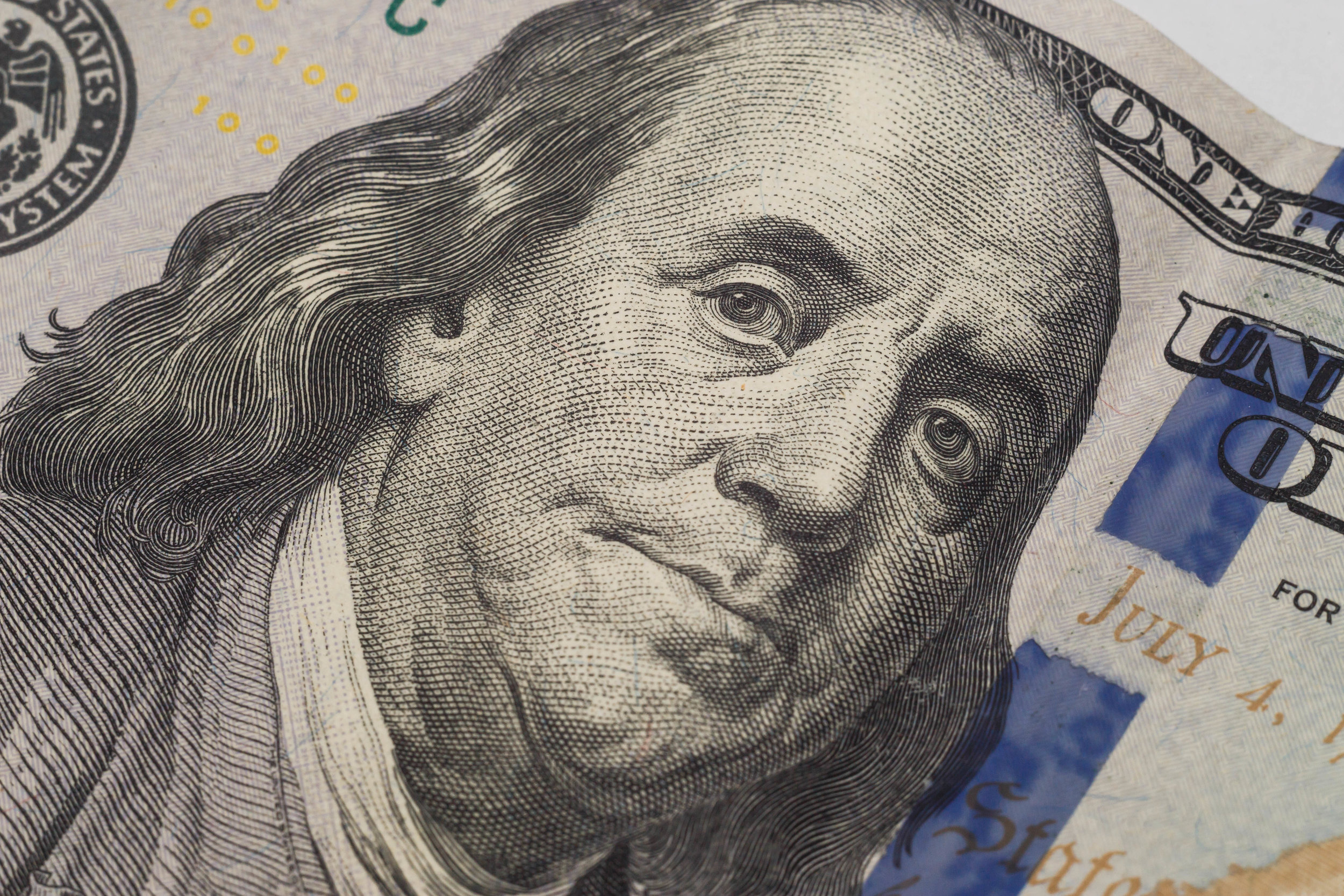 dollars-closeup-benjamin-franklins-portrait-on-P8RJV5K.jpg