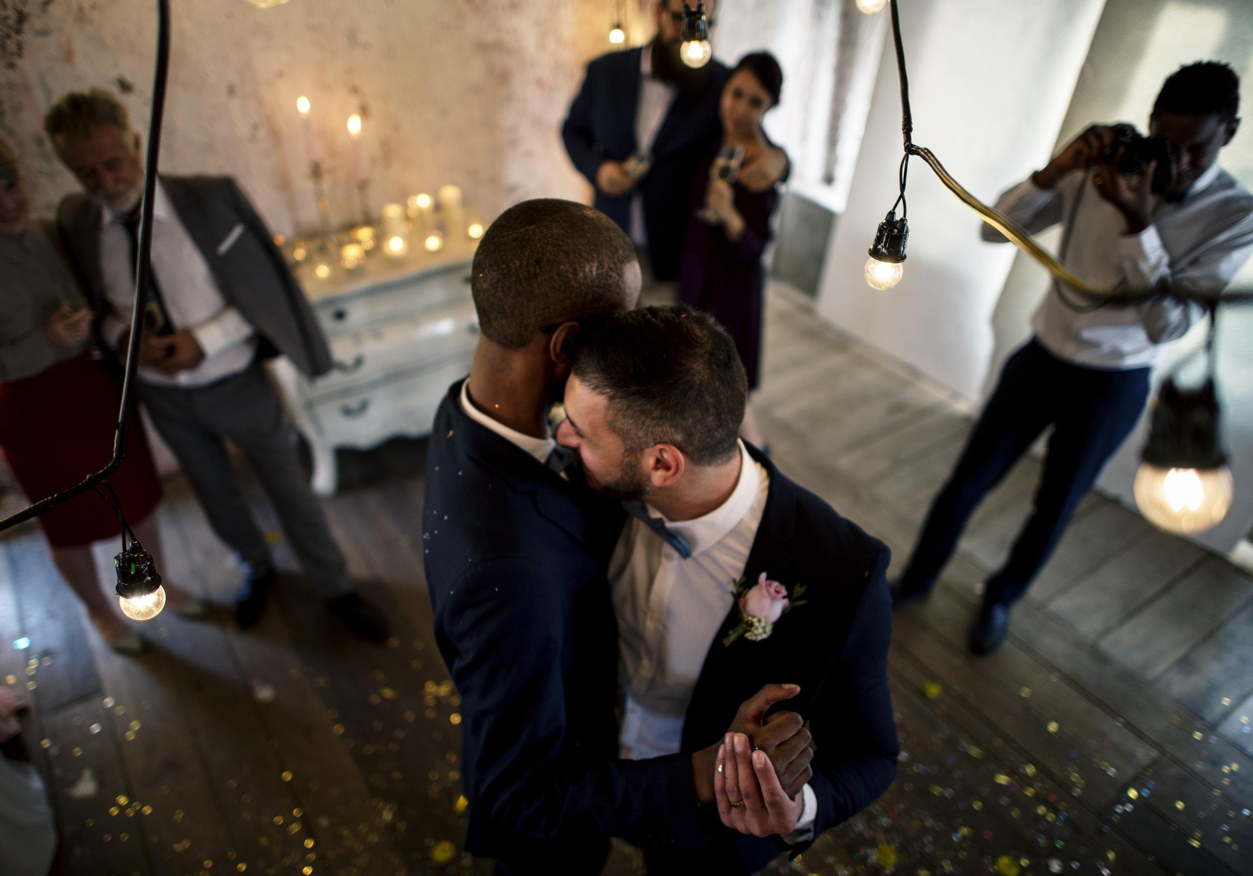newlywed-gay-couple-dancing-on-wedding-PUXPMW7.jpg