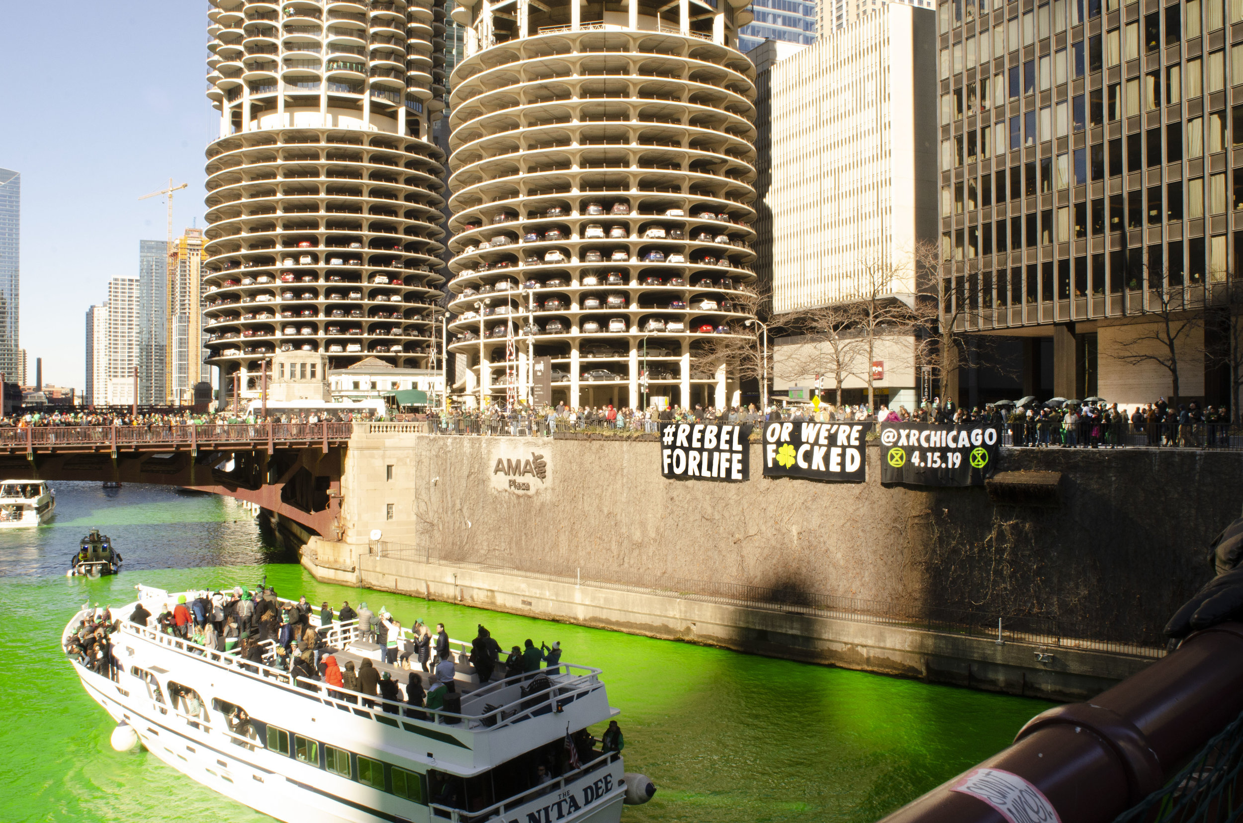 Extinction Rebellion Chicago protesting at Chicago's yearly St. Patrick's Day river dyeing