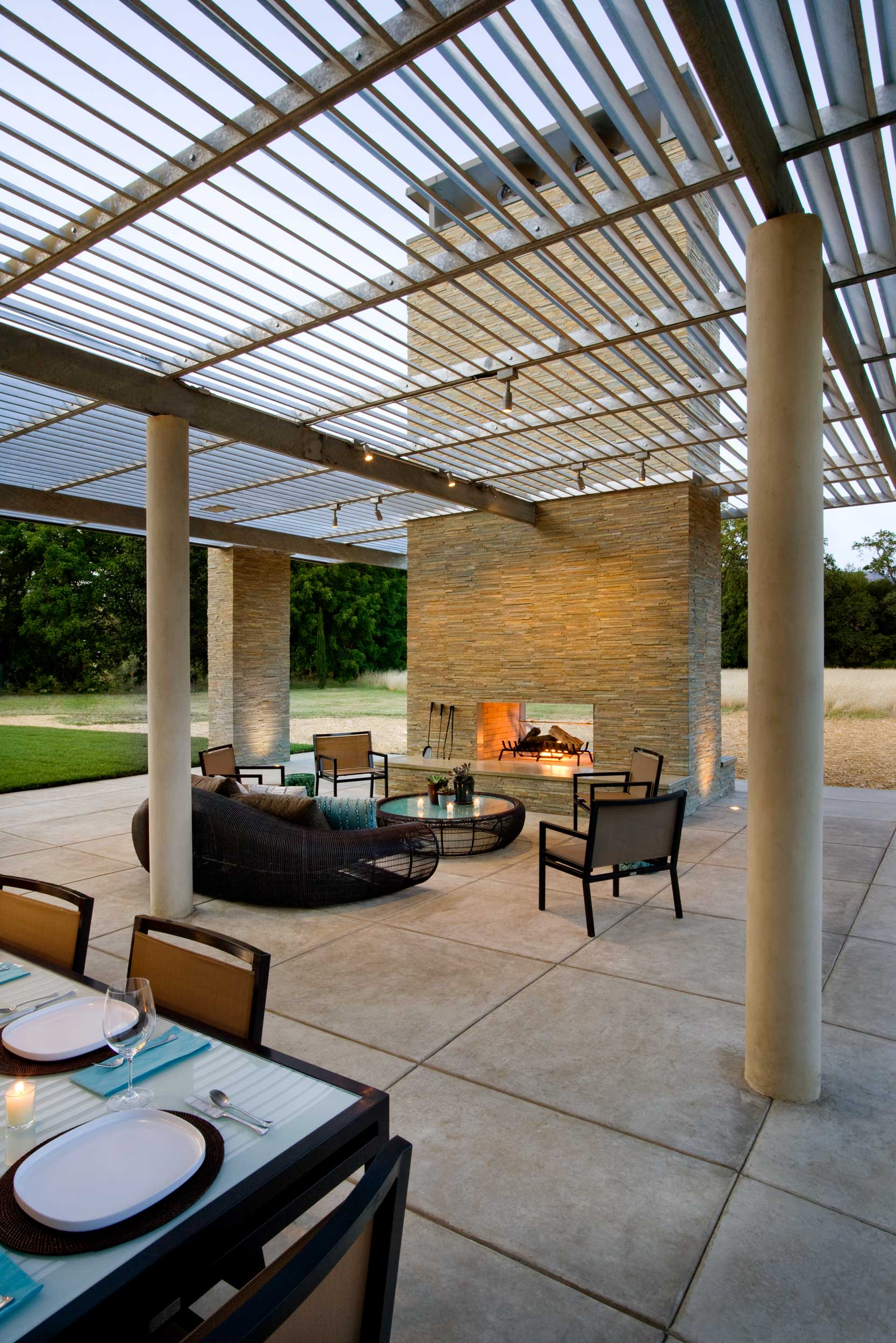 View of Pool House Patio and Outdoor Fireplace