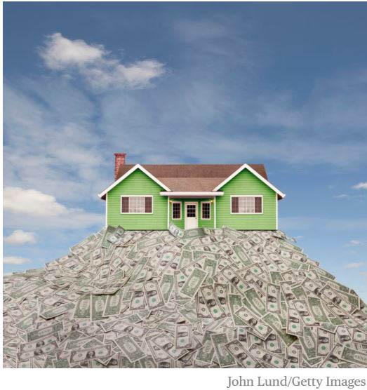 Reverse mortgage - house on pile of money.JPG