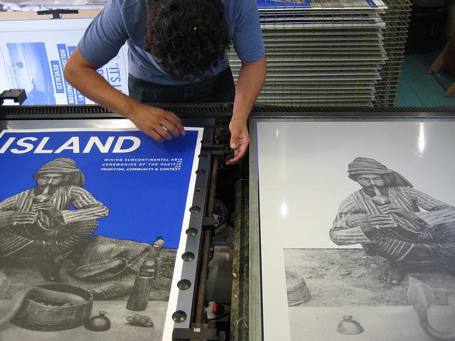 Artist Trent Walter printing on the Big Fag