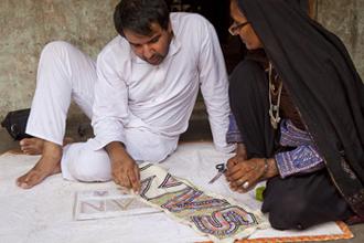 Designer Ishan Khosla and embroiderer Sajnu Ben design the Sangam logo