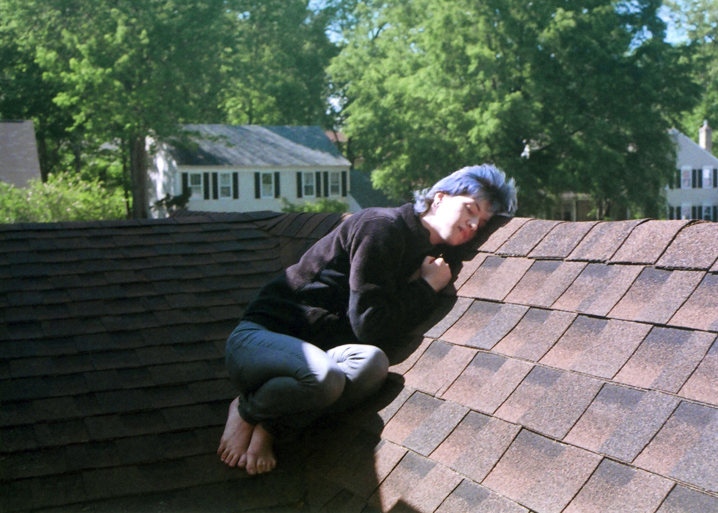 Sarah on the roof outside their bedroom.