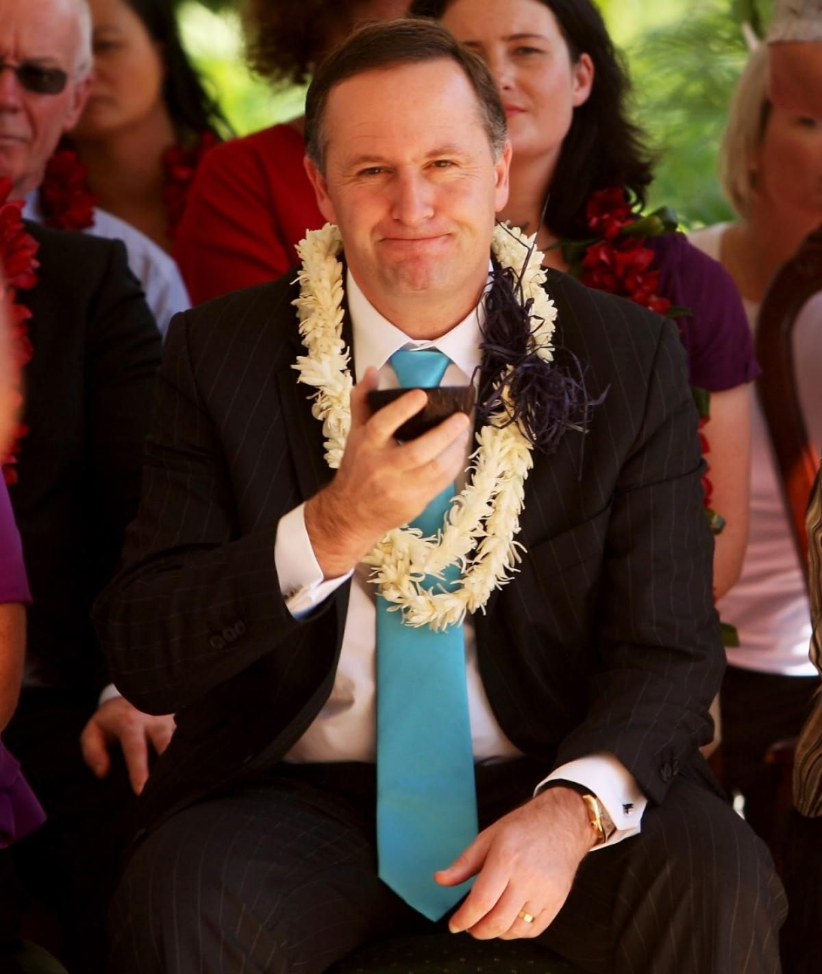 John Key after a shell of kava in Samoa