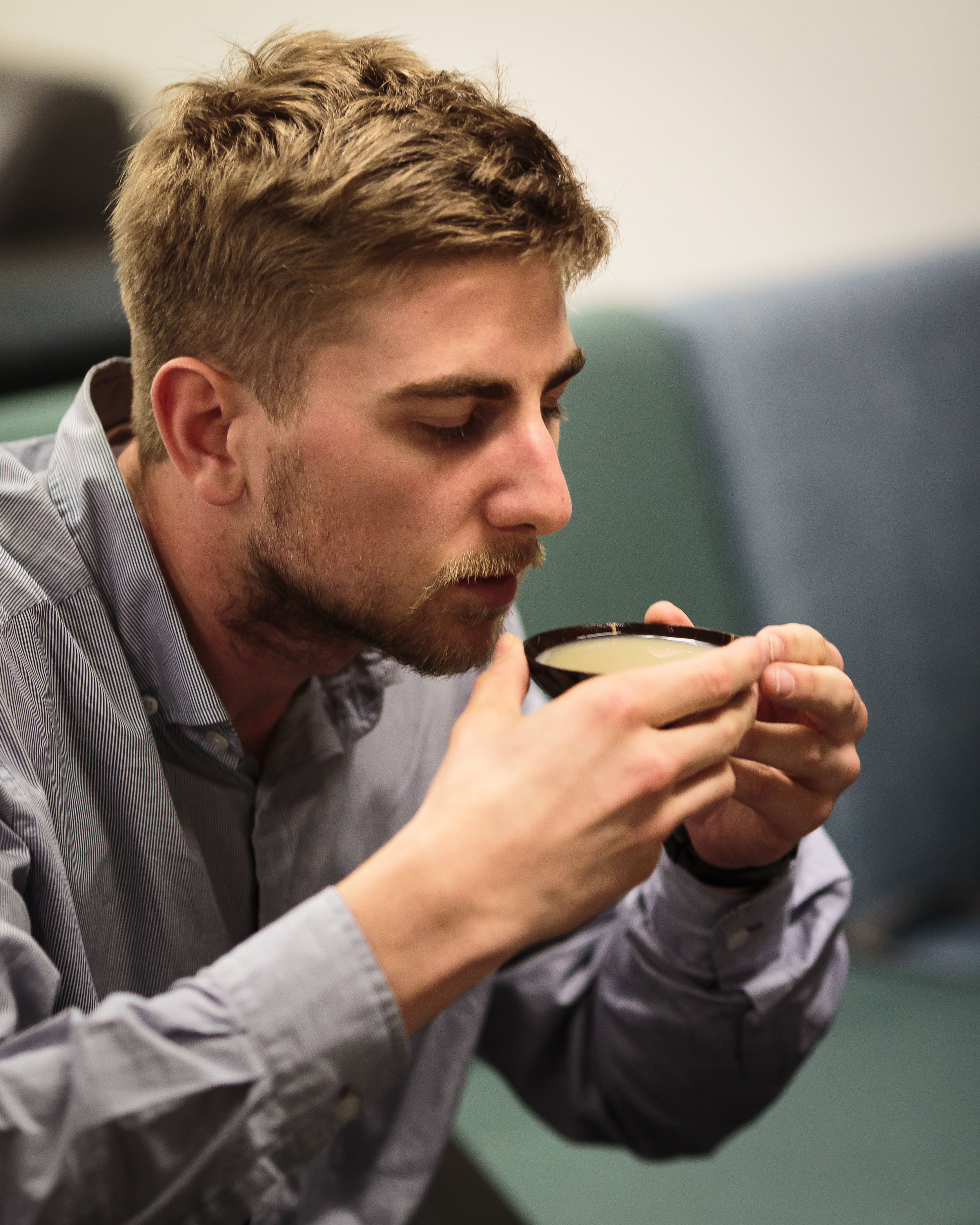 A kiwi journalist trying kava for the first time at the University of Auckland (photo by Todd Henry)
