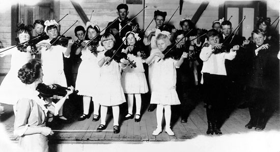 Pictured above: Mary V. Dodge teaching her first orchestra, the Harney County Sagebrush Symphony Orchestra, from 1912-1917. Later she moved to Portland to conduct the Irvington School Orchestra.