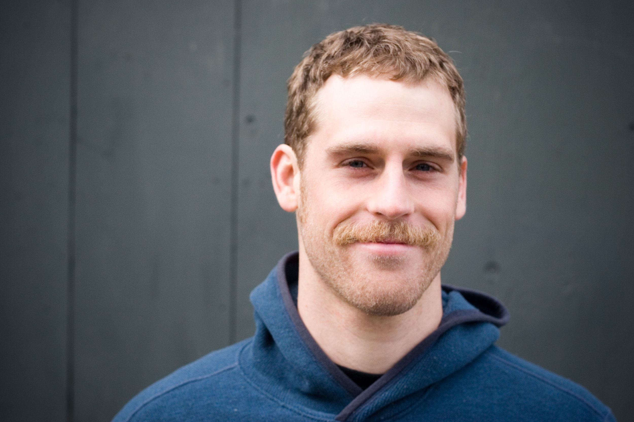 """Erik Hanson, Revelstoke BC - """"The purpose of art is not the release of a momentary ejection of adrenaline but rather the gradual, lifelong construction of a state of wonder and serenity.""""― Glenn GouldErik, aka """"Happy"""" hails from Powell River, BC. In the past few years he has spent time in Tofino and Victoria, and now lives in Revelstoke as a forest fire fighter. He is passionate about Art, Social Change, Reading, Rockclimbing, Kindness, Graphic Facilitation, Surfing, Biking, Kiteboarding and skateboarding on sunny days. A natural leader and doer, Erik is founding member of extremekindness.com, a crew leader on the Monashee Unit Crew, a R&D specialist for Ocean Rodeo, A board member for """"1% for the Hungry"""". Erik believes that nature is our default, it perpetuates change and adventure. Mother Nature runs the healthiest operating system and it's important to check in every once an a while. He is an active participant in LILI's because it provides him with a chance to contribute and learn."""