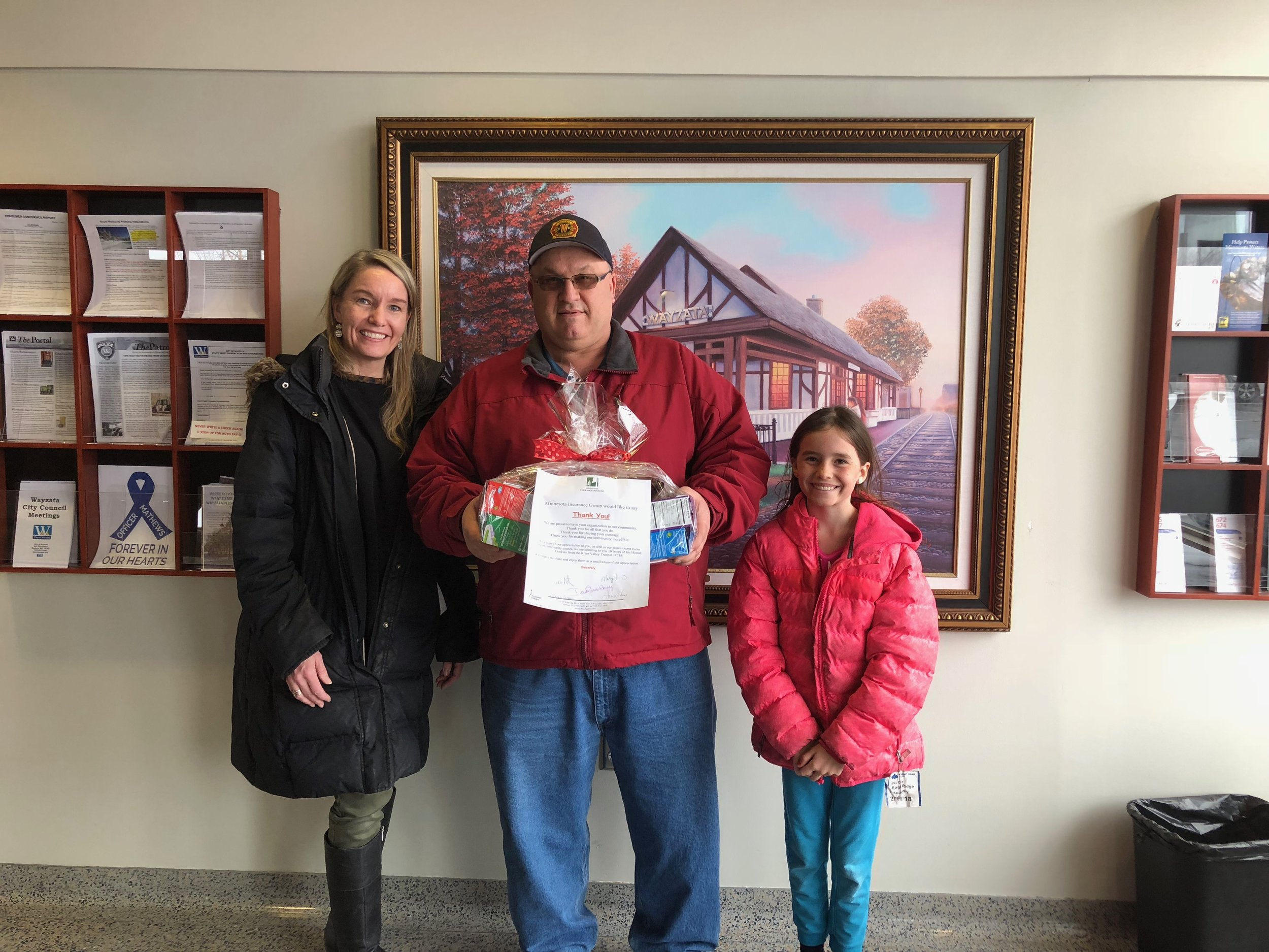 Donating Girl Scout cookies to Wayzata Fire Station