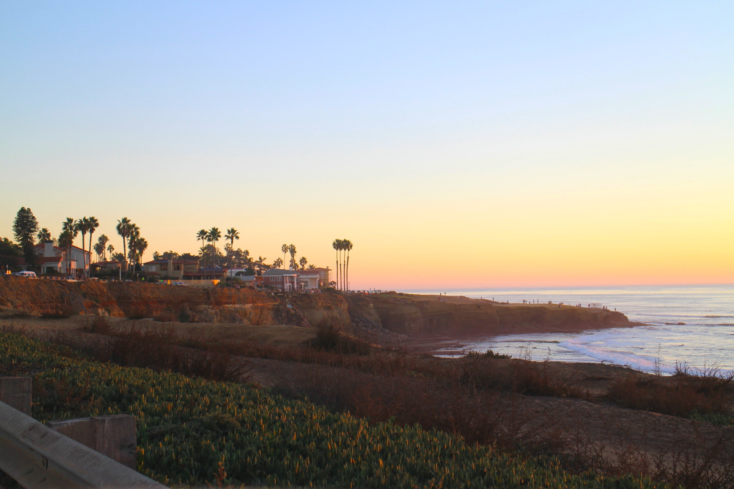 I drive about 10 minutes from my house and reach the Sunset Cliffs. These are not just an attraction for visitors; locals like to go there for a run along the one and a half mile long shoreline - part of the Sunset Cliffs Natural Park -, meditate, have picnics, and watch the sun set.  If you rather feel like driving, start at Adair St. in Ocean Beach and then simply follow Sunset Cliffs Boulevard.   The views are  always  stunning, no matter if rain or shine.  It's the perfect spot away from the city life (although right in the city), and around sunset time, it gets fairly busy. This, however, depends on the clouds, of course. You can watch the (advanced) surfers ride the perfect waves. San Diego is such a surfer hub. Ocean-gazers, you will enjoy this spot.  I love to come here, to clear my head, have a moment of appreciation and be happy that I have the chance to live in this city, to be able to go a way that I have been wanting to got for many years - and embrace life to the best of my ability.  If it's a clear evening, be prepared for a dramatic sunset!  (But please don't look at your phone as you go; you are running the risk of falling from the cliffs. Not kidding: this has happened before, sadly.)
