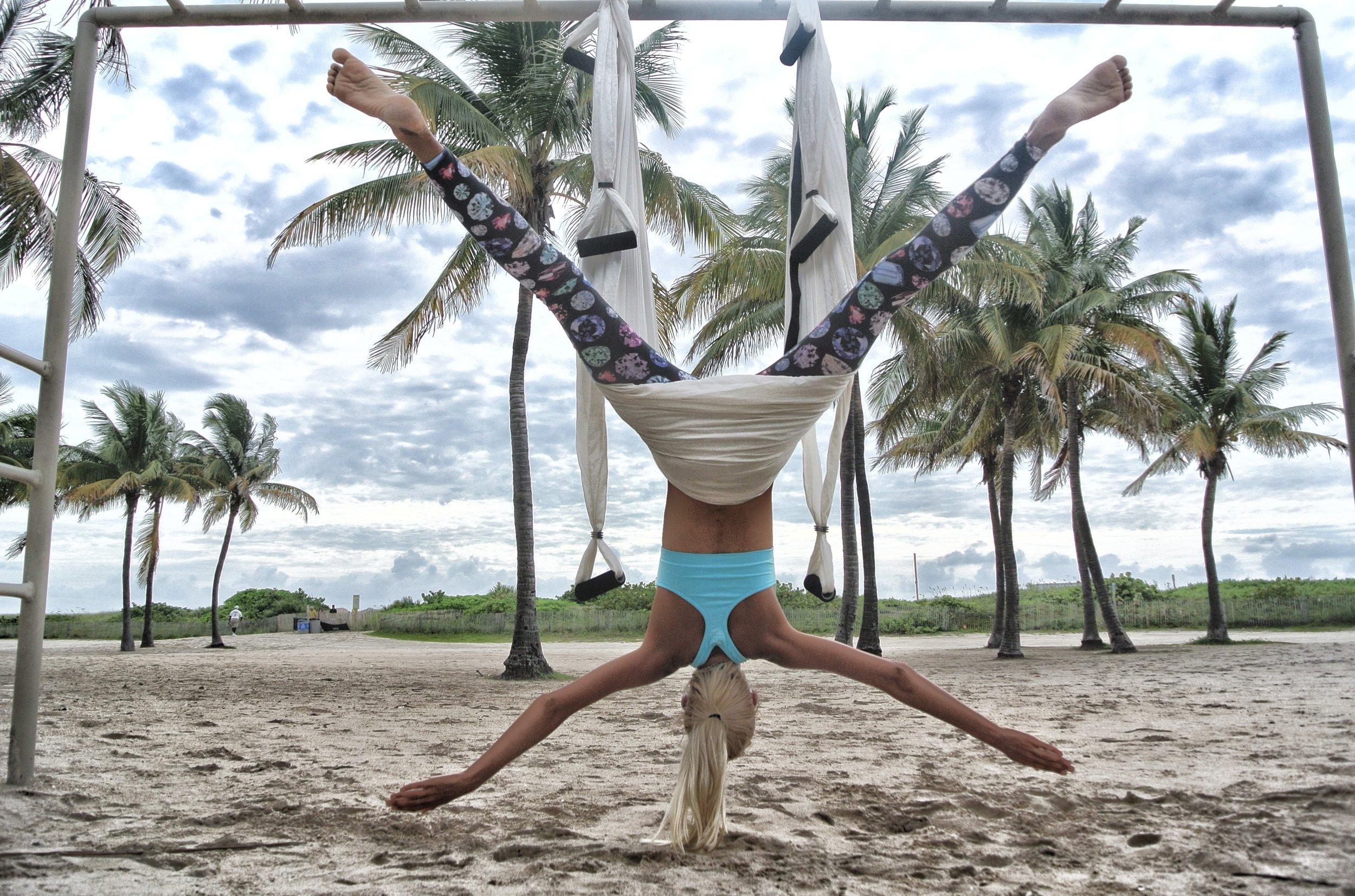 aerial-yoga-anti-gravity-yoga-beach-705122.jpg