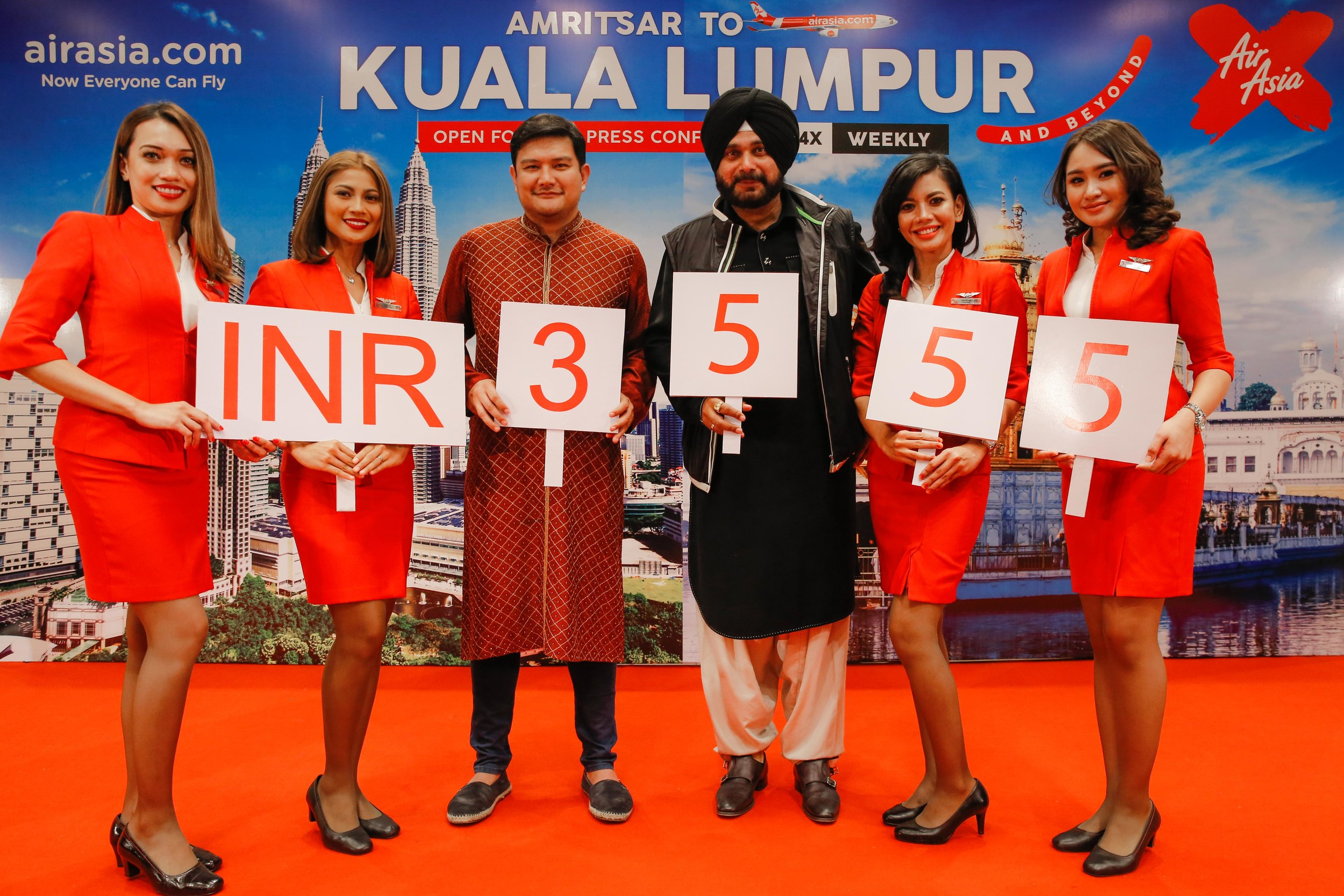 (From Left to Right)  AirAsia X Malaysia CEO, Benyamin Ismail and Punjab Minister for Tourism & Cultural Affairs, Shri. Navjot Singh Sidhu being flanked by cabin crews at the launch of AirAsia X's latest direct flight to Amritsar from Kuala Lumpur.
