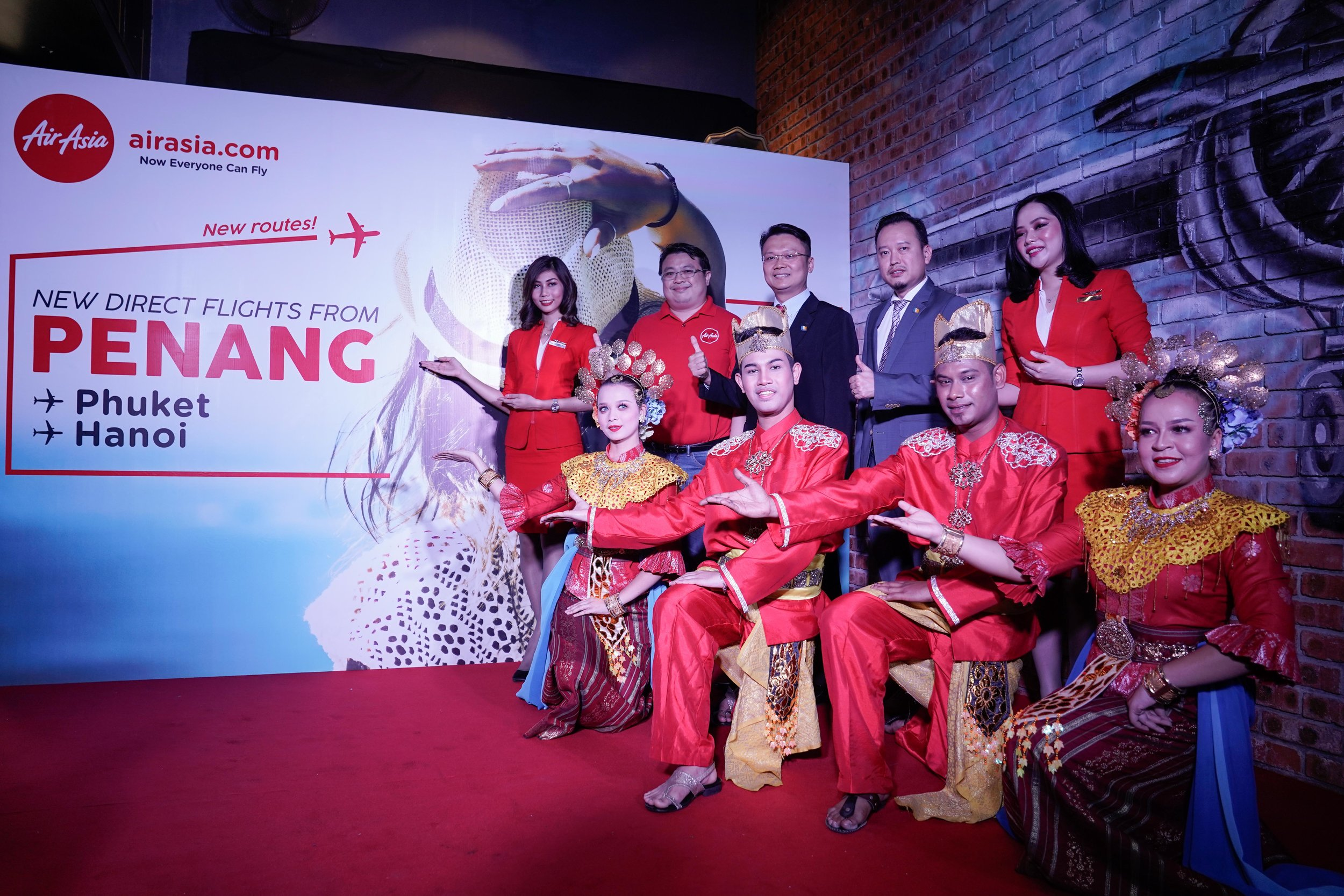 Photo Caption (From top second left to right): AirAsia Malaysia Head of Commercial Spencer Lee, Penang State Executive Councillor for Tourism Development, Heritage, Culture and Arts YB Yeoh Soon Hin, and Penang Global Tourism CEO Mr. Ooi Chok Yan celebrating the two inaugural international flights from Hanoi and Phuket into Penang.