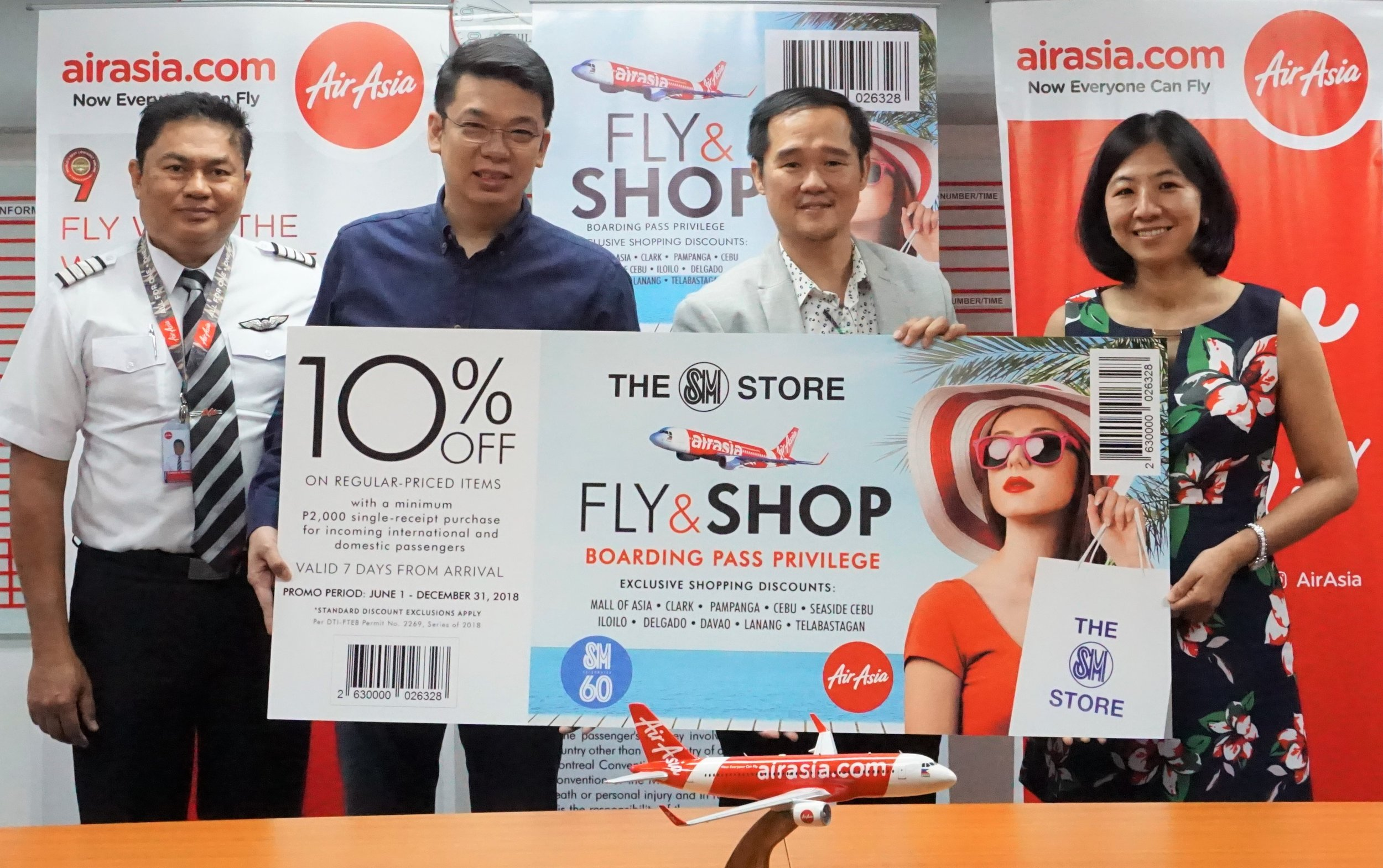 Caption (L-R) AirAsia Philippines Director for flight operations Captain Gomer Monreal, AirAsia Philippines Commercial Director Gilbert Simpao, The SM Store SVP Eugene Saw and The SM Store VP Quennielyn Cua.