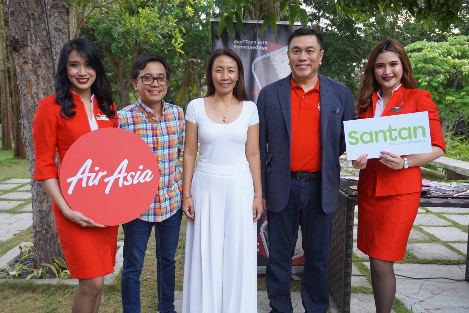 Photo Caption:(L-R) AirAsia Philippines Head of Ancillary Karlo Sanchez, COO of Amorita Resort Lyba Godio and AirAsia Philippines CEO Capt. Dexter Comendador flanked by AirAsia Cabin Crew.