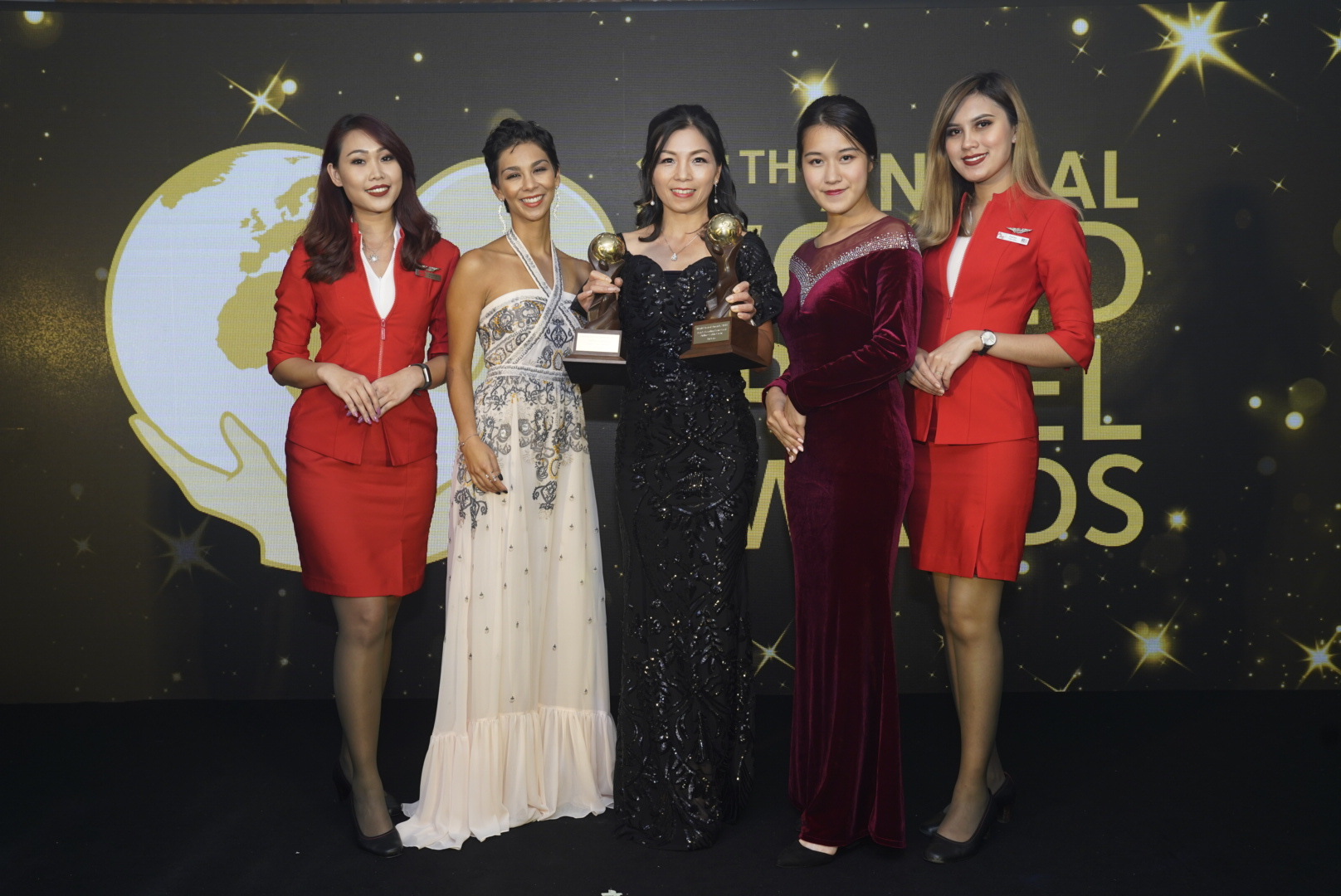 AirAsia Hong Kong and Macao CEO Celia Lao with the trophies for Asia's Leading Low-Cost Airline and Asia's Leading Low-Cost Airline Cabin Crew at the 2018 World Travel Awards Asia and Australia.