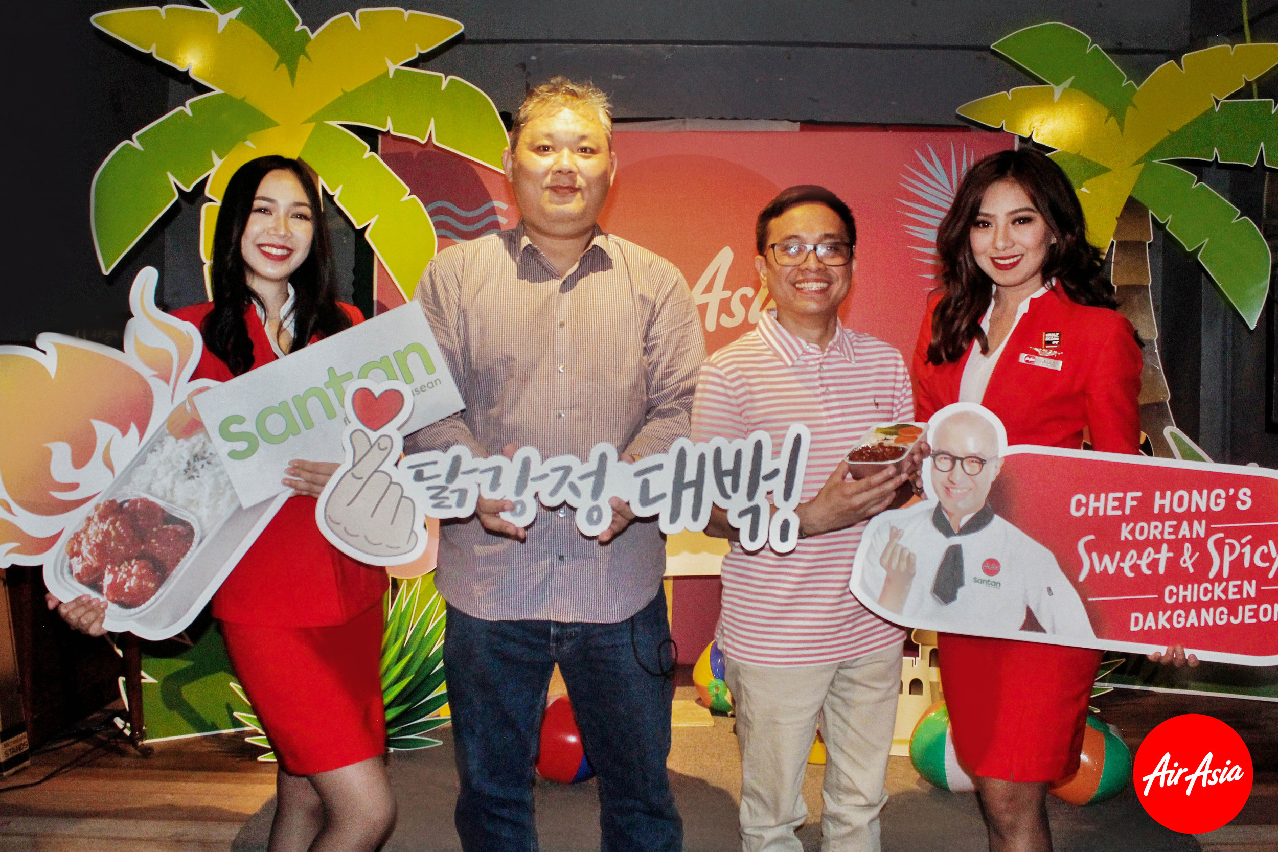 Photo Caption: (Second from left) AirAsia Regional Head of Inflight Food & Beverage William Tan and AirAsia Philippines Head of Ancillary Karlo Sanchez at the new Santan Celebrity Chef Series launch in Manila, Philippines flanked by AirAsia cabin crew.