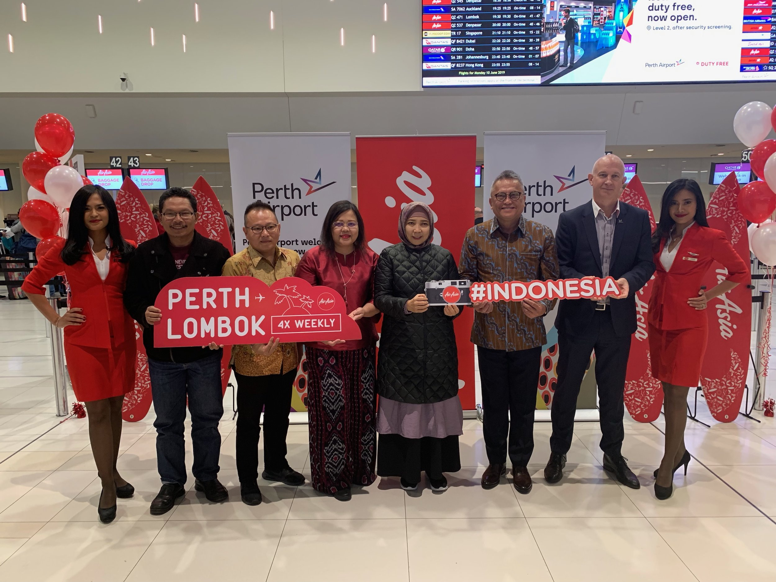 Photo Caption (From Left): Rosiady Sayuti, Provincial Secretary of West Nusa Tenggara Province, Indonesia; Rifai Taberi, Commercial Director of AirAsia Indonesia; Dewi Tobing, Consul General of the Republic of Indonesia in Perth; Sitti Rohmi Djalilah, Vice Governor of West Nusa Tenggara Province, Indonesia; Robert Waloni, Senior Adviser to the Minister for Air Accessibility, Ministry of Tourism Republic Indonesia and Kevin Brown, Perth Airport CEO flanked by cabin crew