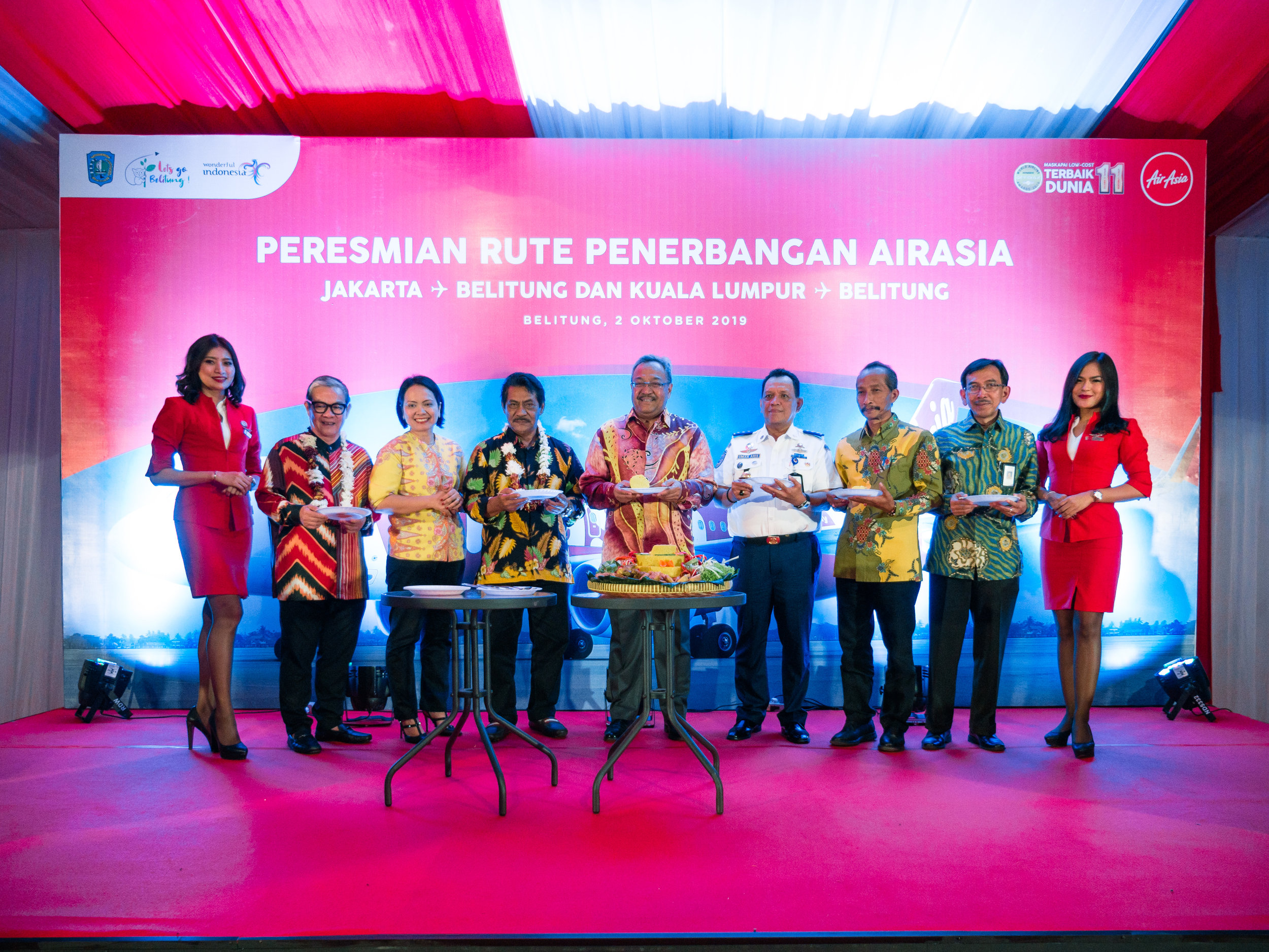 (From left to right) Independent Non-Executive Director of AirAsia Group Berhad, Dato' Fam Lee Ee; AirAsia Indonesia Deputy CEO Veranita Yosephine; Regent of Belitung Sahani Saleh; Malaysia's Ambassador to Indonesia, His Excellency Zainal Abidin Bakar; Special Staff of Minister of Transportation on Law and Bureaucracy Reform, Dr Umar Aris; Head of Tourism Department of Bangka Belitung Islands,  Rivai;  Special Staff of the Minister of Tourism on Tourism Infrastructure, Judi Rifajantoro flanked by AirAsia cabin crew during the inaugural ceremony of AirAsia's flights in Belitung.