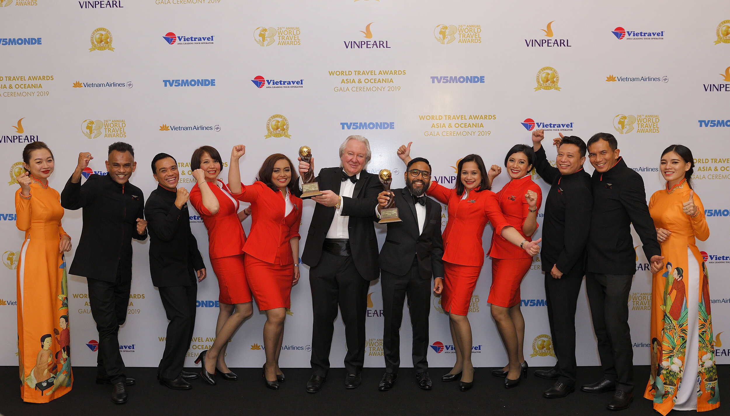 Photo Caption: AirAsia Malaysia CEO Riad Asmat and a group of AirAsia's pioneer cabin crew accepted the Asia's Leading Low-Cost Airline and Asia's Leading Low-Cost Airline Cabin Crew awards from President and Founder of World Travel Awards Graham Cooke (centre right).
