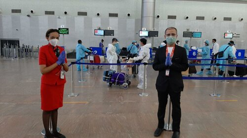 AirAsia Ground and Cabin Crew ready to assist passengers to be repatriated from India to Manila.
