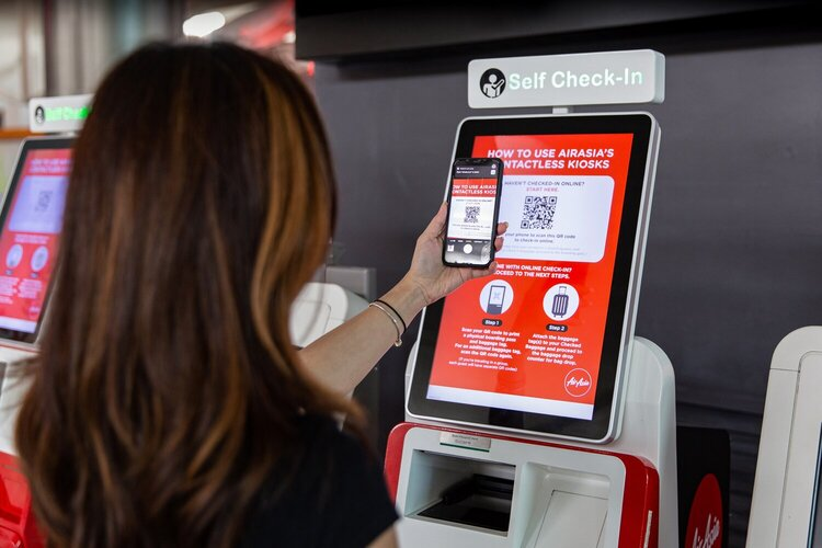AirAsia check-in kiosks at airport terminals have been designed to perform contactless transactions by scanning QR codes of flight bookings from mobile devices or printed boarding documents.