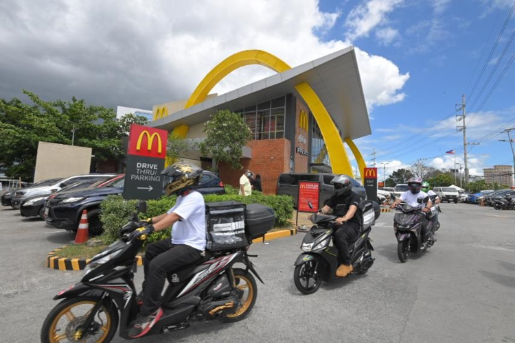 The airasia delivery team ready to deliver delicious McDonald's meals