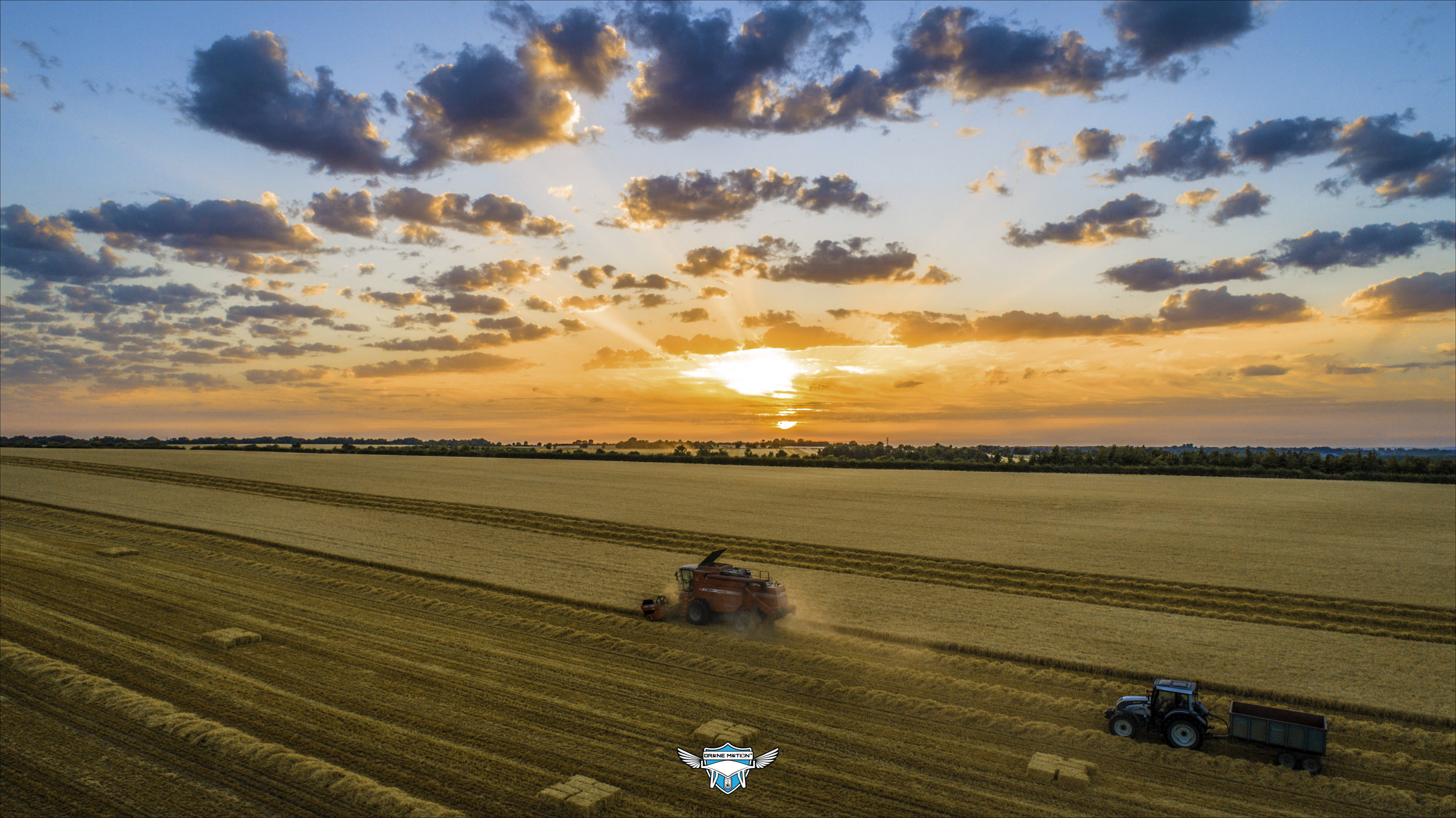 Sunset Shot of Combine & Tractor.jpg