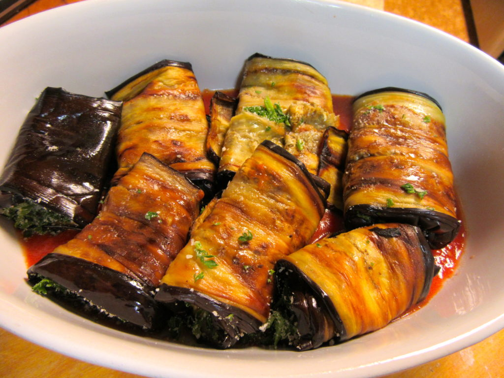 Place the eggplant rolls in baking dish. Spoon tomato sauce over the rolls and then top with the tomato olive mixture. Bake in 395 F. degree oven for 25 minutes. Take out of the oven and enjoy.