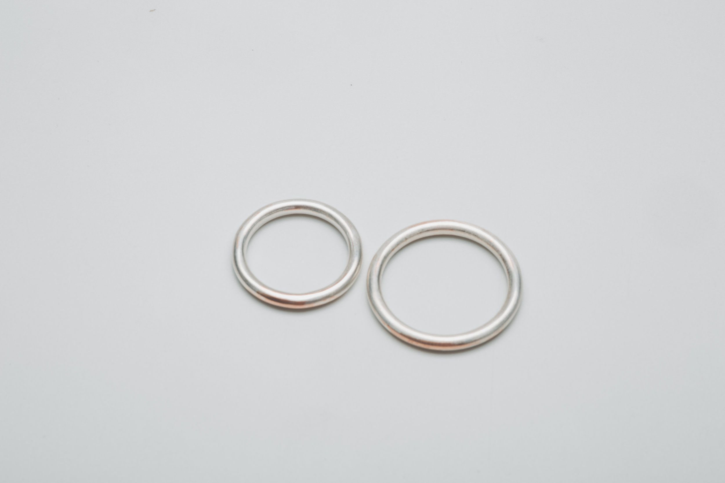 Wedding bands. Rose gold 18k rings covered by thin layer of sterling silver that fades away and only the real and precious stays.