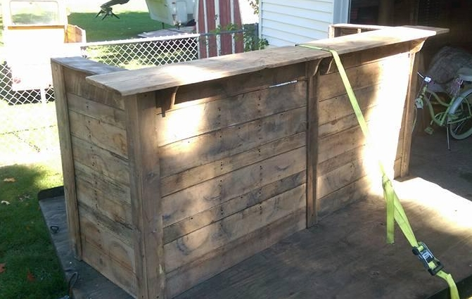 Handmade Bar, made from rustic wood by Kirt Peterson. He started making home decor and furniture out of pallets a few years ago, and now made and amazing piece for us. He works on his relative's dairy farm and is passionate about agriculture which is why he wanted to donate to Dairy Discovery.