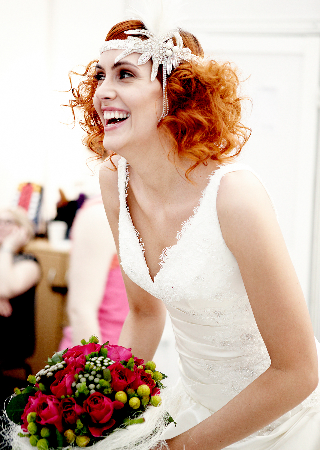 red haired bride laughing