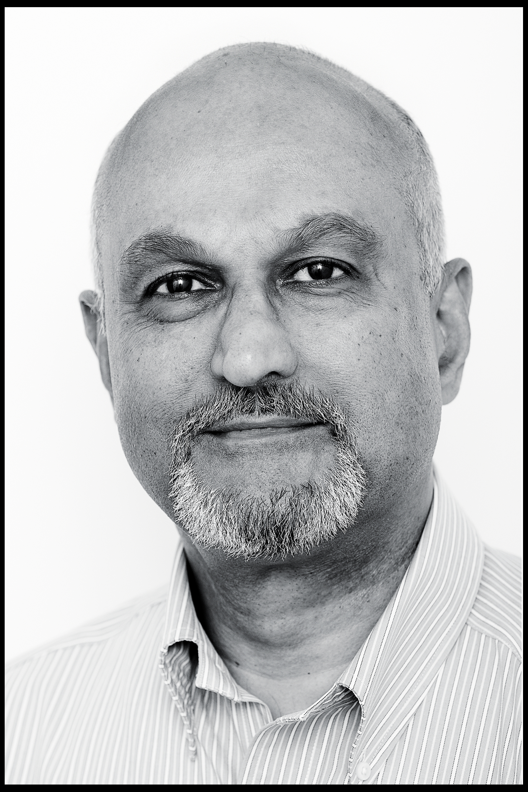 corporate headshot of a man with a beard