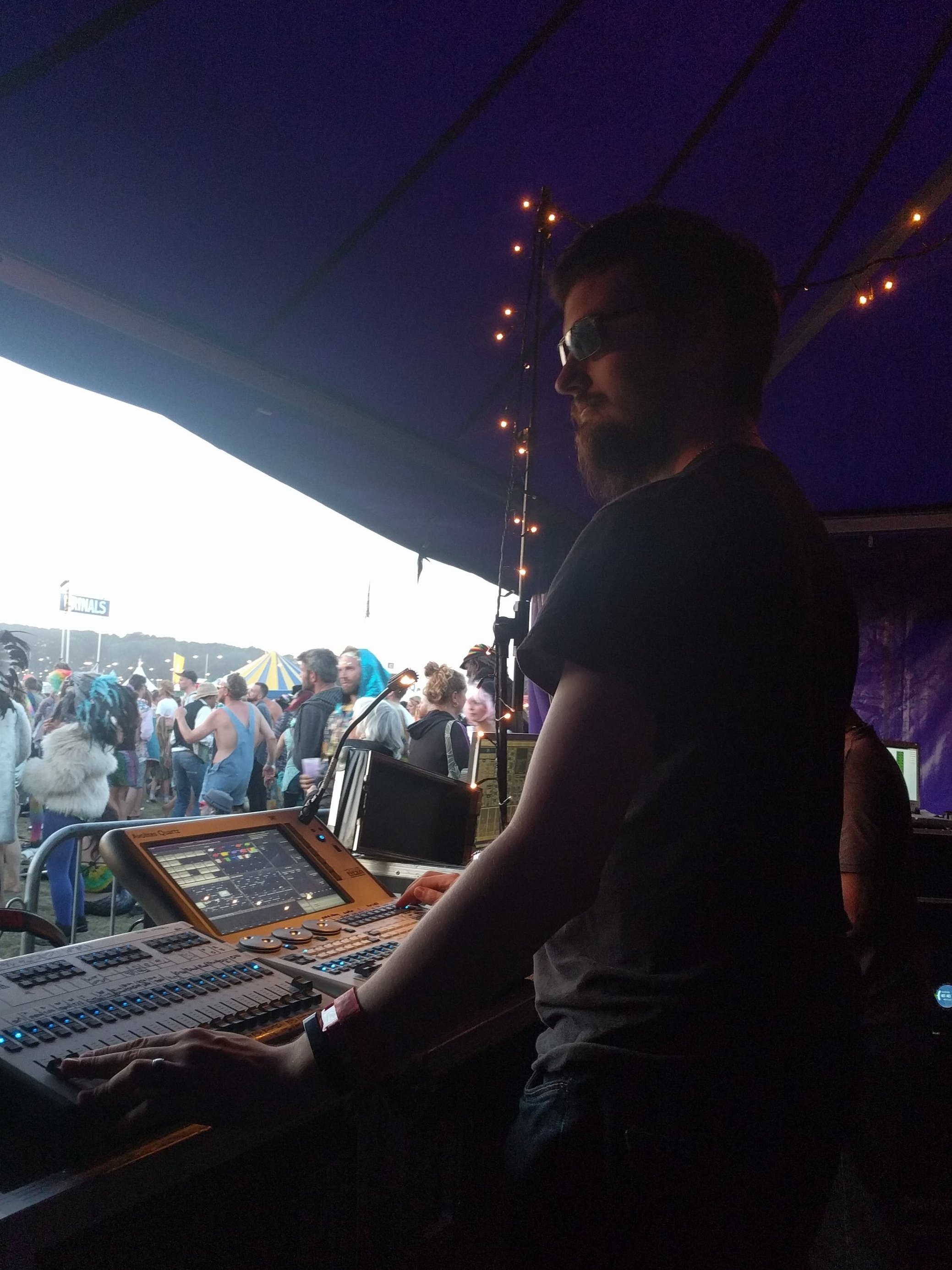 Robb operating lighting on the main stage at Shambala Festival 2017