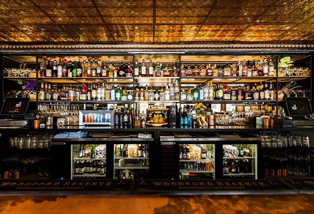 Hightail - A Local Watering Hole with a fully stocked custom bar 🥃 Photo by: Hailey Bollinger . . . #interiordesign #hospitalitydesign #bardesign #cincinnati #design