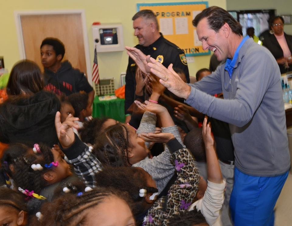 Len Mattiace gets high-fives from kids during a Players Championship Charities function in 2014 at the Eastside Police Athletic League of Jacksonville. Mattiace's foundation has launched an anti-bullying campaign in Duval County schools. [Bob Mack/The Times-Union]