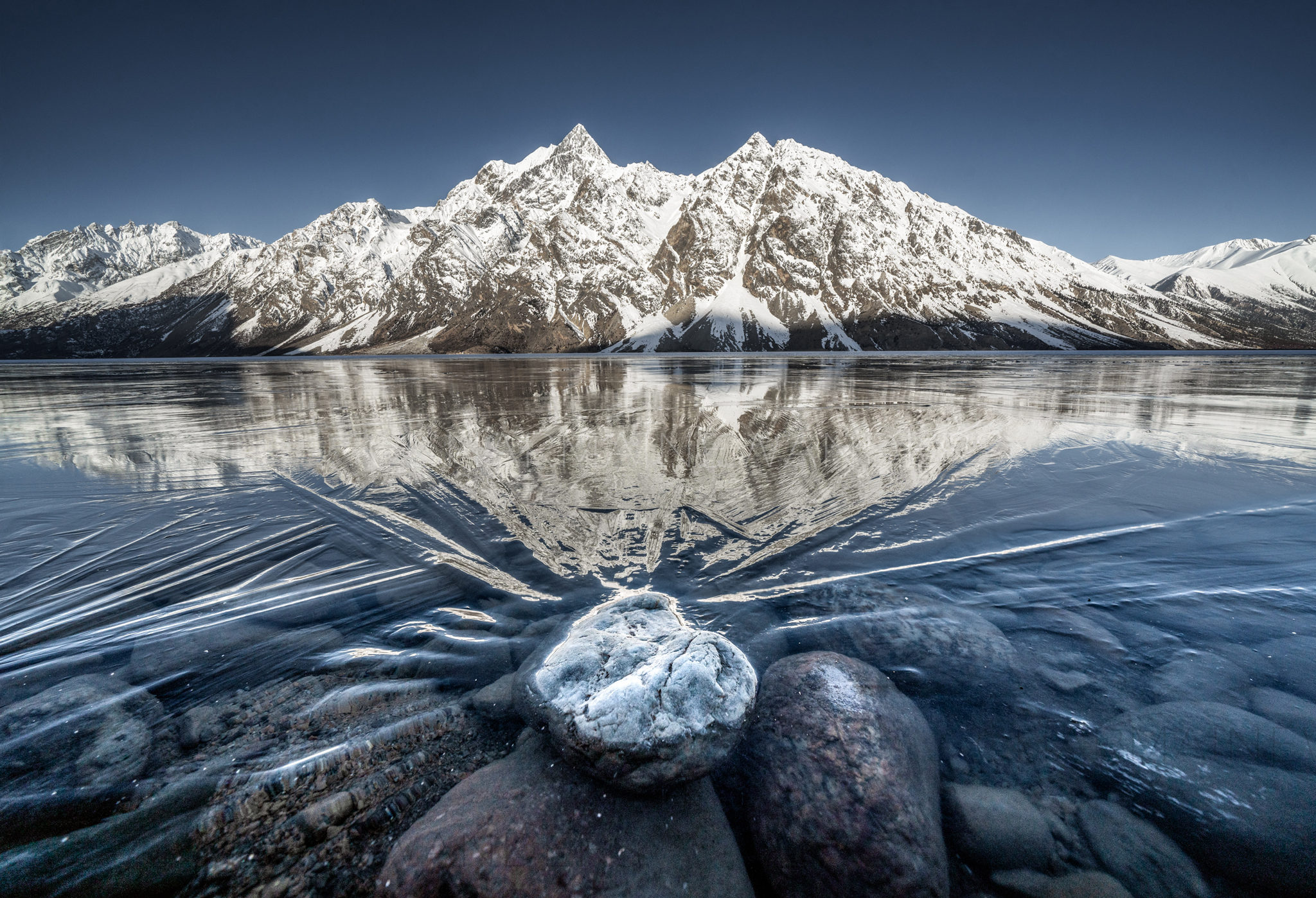 TibetLandscapes-mountnrockrflecn_WM.jpg