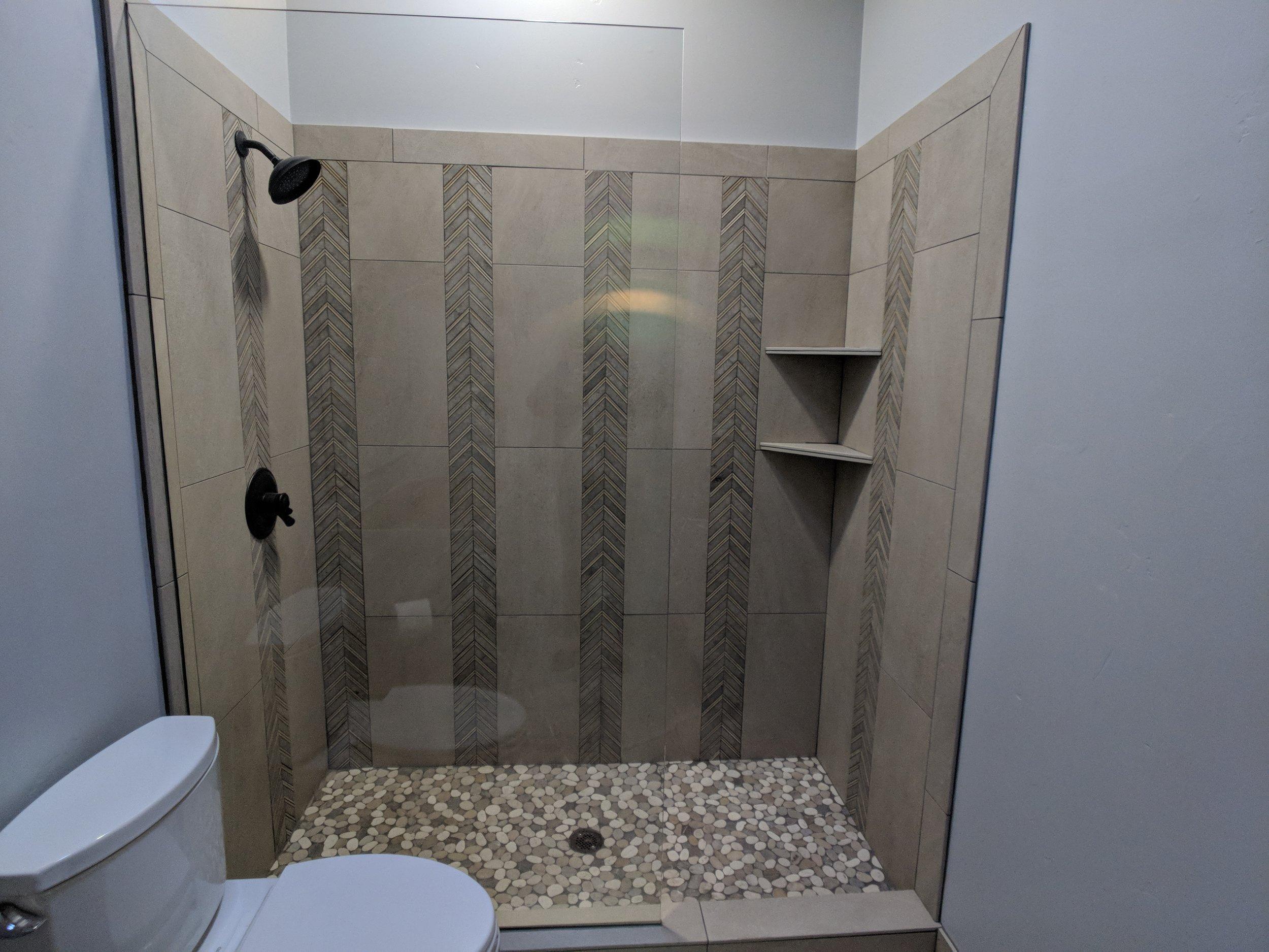 holland-bathroom-shower-pebble-floor.jpg