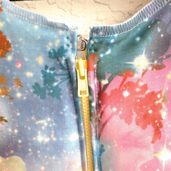 (Image: An  Inner Senshi space binder  with a  yellow front zipper , close-up on the metal clasp and top stops. Did you know you can request a colored zipper in your order notes?)