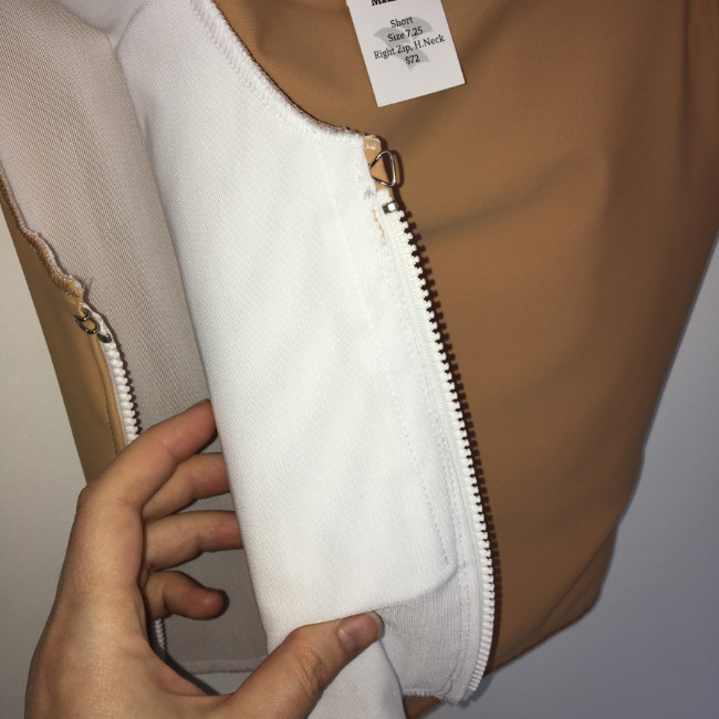 (Image: A  Madrone skin-tone binder  with a stiff insert and  a side zipper.  We were so excited when we became able to combine these! It's all thanks to Magnus, our trusty needle-feed machine.)