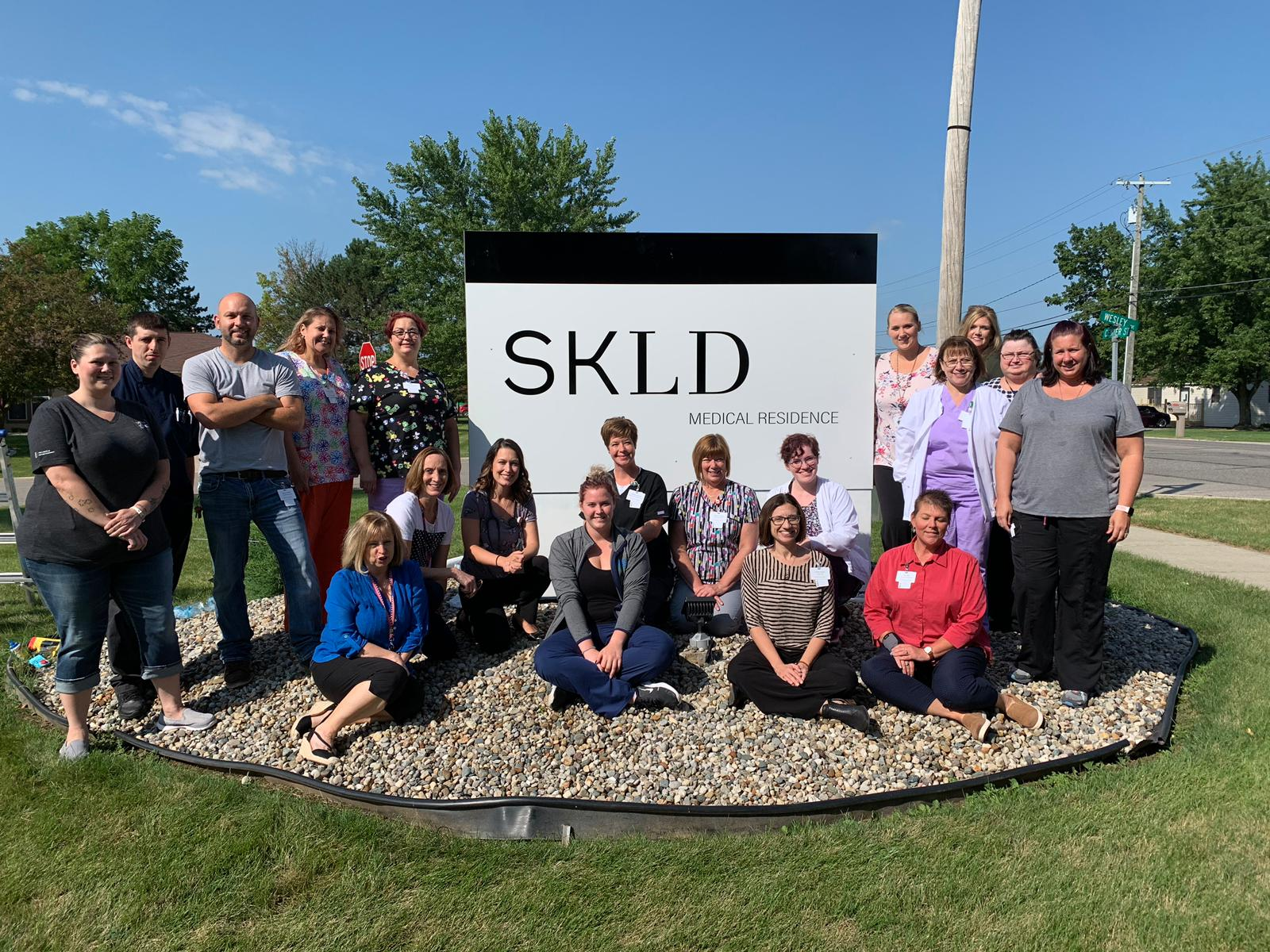 SKLD Bryan was so excited about their new sign, that they interrupted the installation to take a group photo, even before the address was posted.