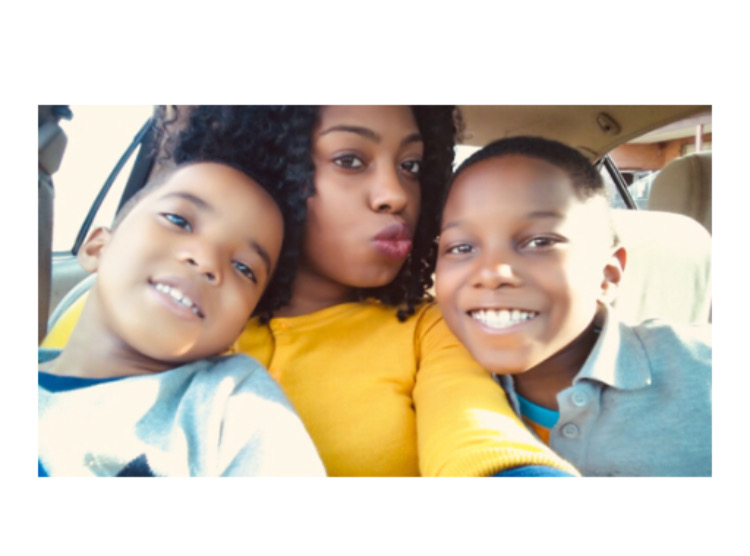 The Reed/Woods family: (Left to right) , Daniel, Kimisha, Gregory