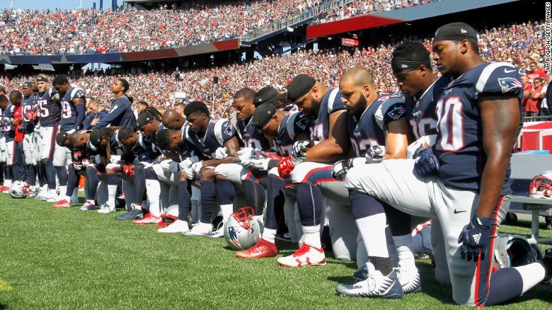 New England Patriots take a knee during the national anthem