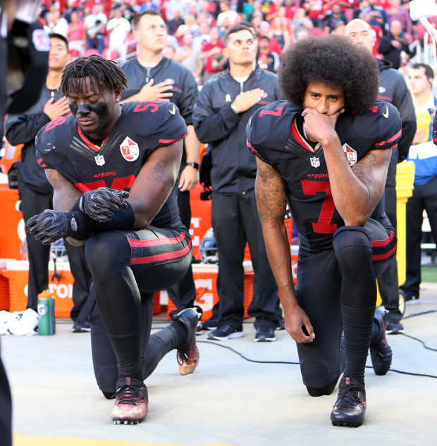 Colin Kaepernick takes a knee during the national anthem